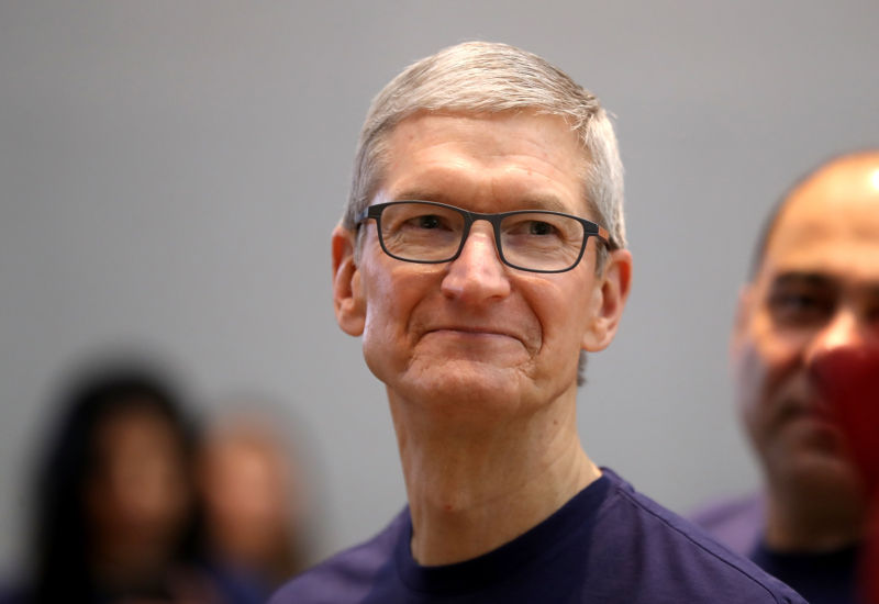 Apple CEO Tim Cook looks like the new iPhone X is on sale at an Apple Store on November 3, 2017 in Palo Alto, California.