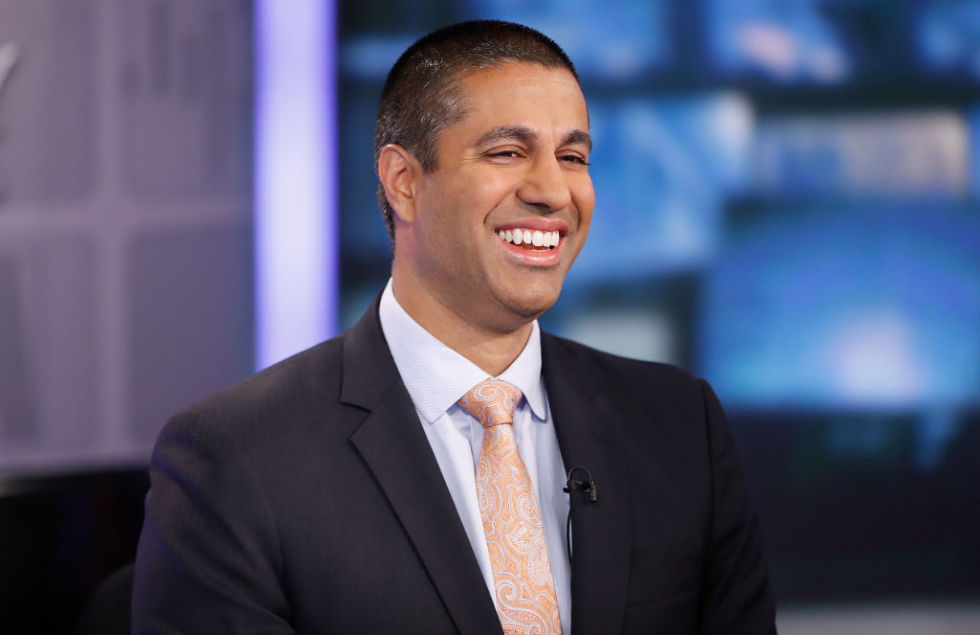 FCC Chairman Ajit Pai smiling during a TV interview.