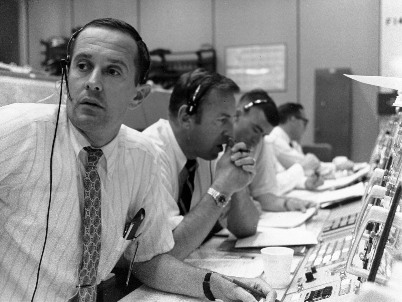CAPCOM Charlie Duke (foreground) with backup commander Jim Lovell (center) during Apollo 11's tense landing.