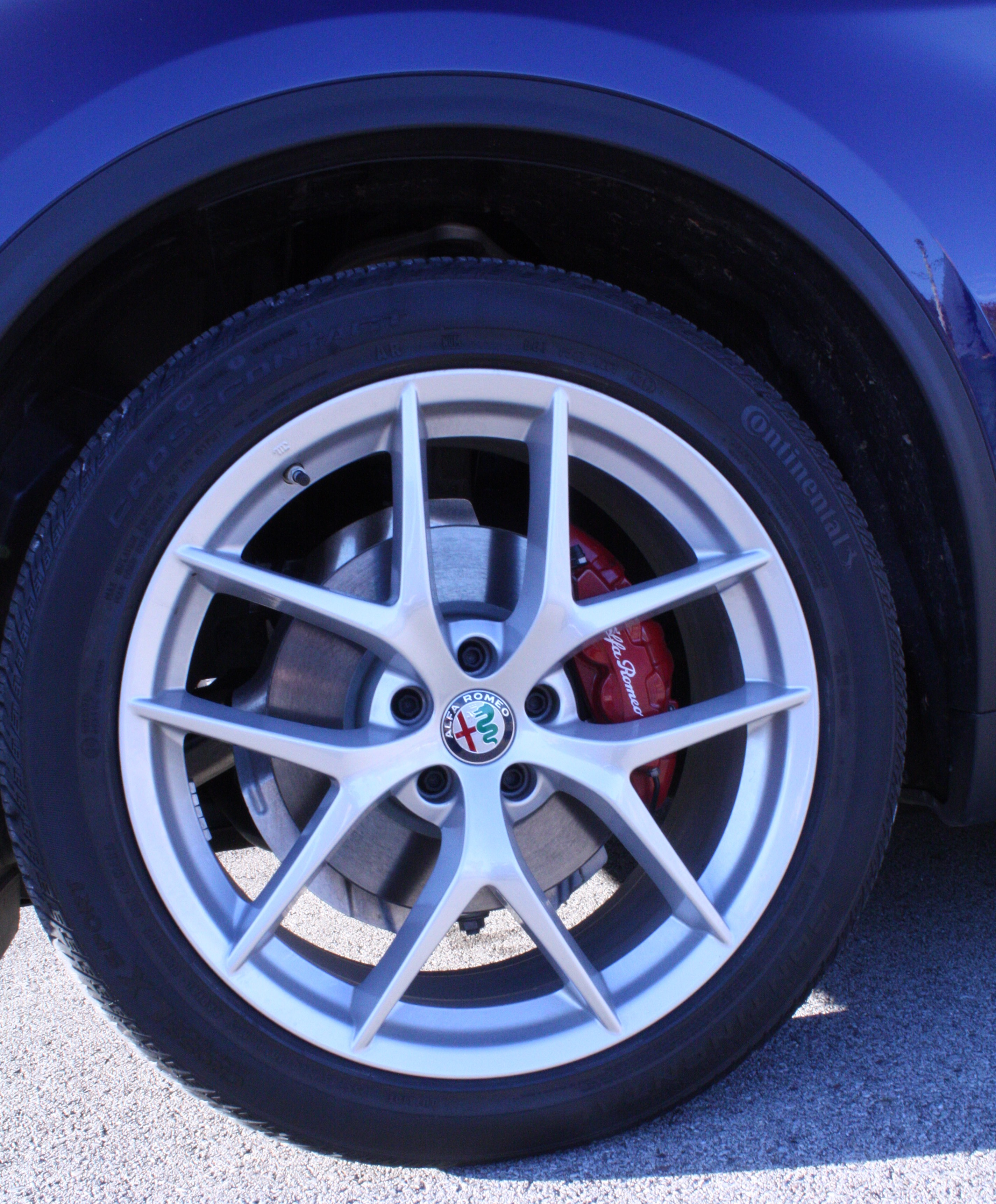 Alfa makes a statement with the wheel design and the red brake caliper.