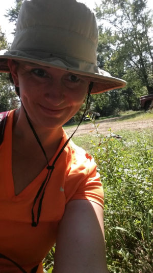 Archaeo-botanist Natalie Mueller with the first clump of wild erect knotweed she ever found.