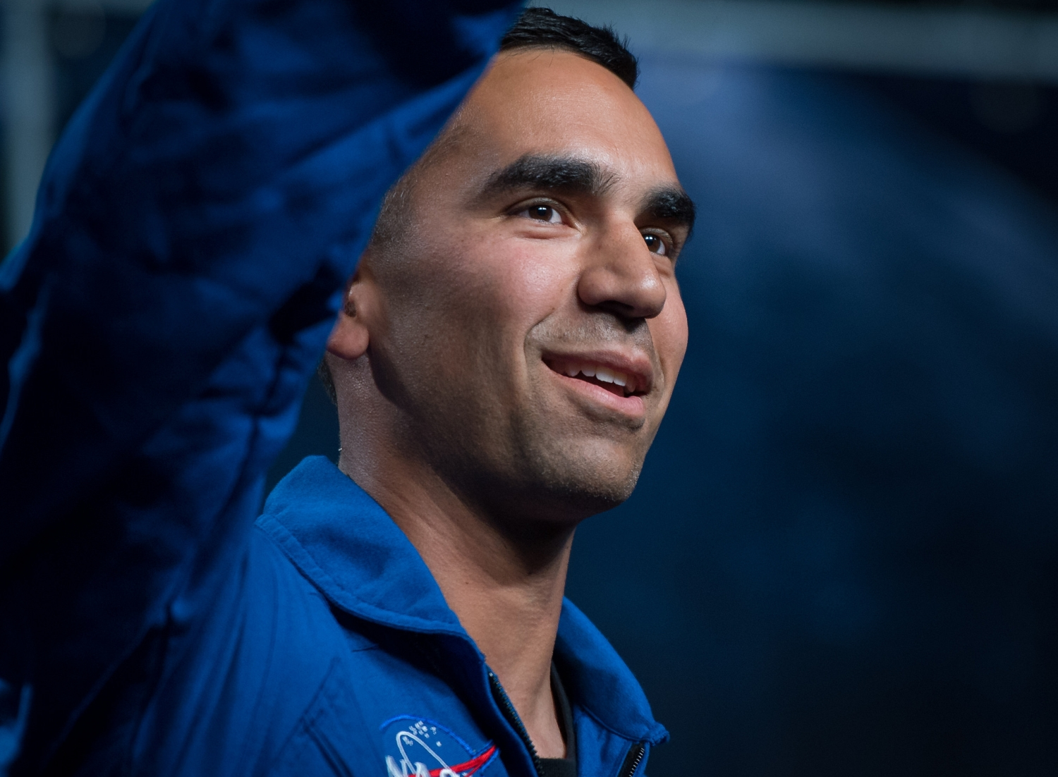 Thirty-nine-year-old NASA astronaut candidate Raja Chari waves as he is introduced as one of 12 new candidates at NASA.