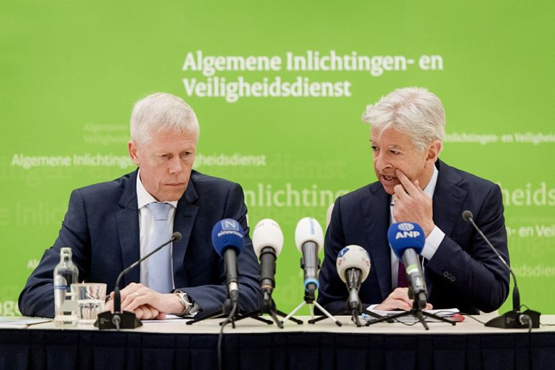Rob Bertholee (L), head of the General Intelligence and Security Service of the Netherlands (AIVD), and Dutch Minister Ronald Plasterk of the Ministry of the Interior, address a press conference on the presentation of the AIVD's annual report in Zoetermeer, the Netherlands, on April 21, 2016. AIVD reportedly penetrated the network of a Russian hacking group directed by Russia's Foreign Intelligence Service (SVR) in 2014, and shared the intelligence with the US.