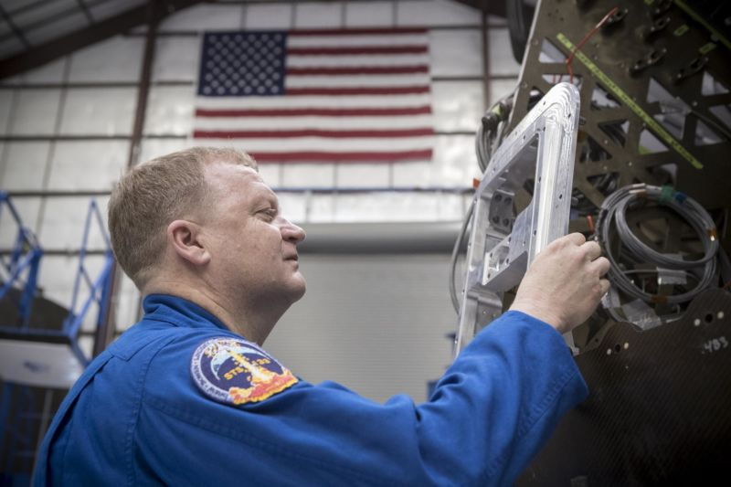 Commercial Crew Astronaut Eric Boe examines hardware during a tour of the SpaceX facility in Hawthorne, California.