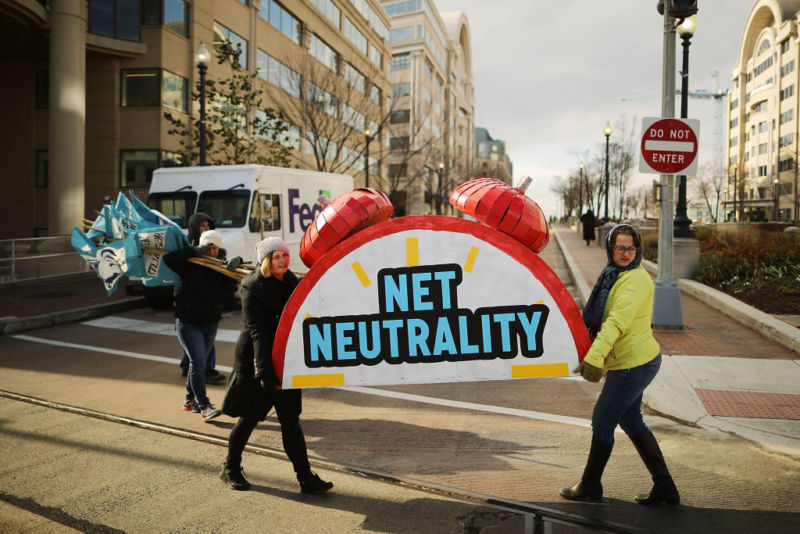 Net neutrality supporters holding a net neutrality sign outside the Federal Communications Commission building.