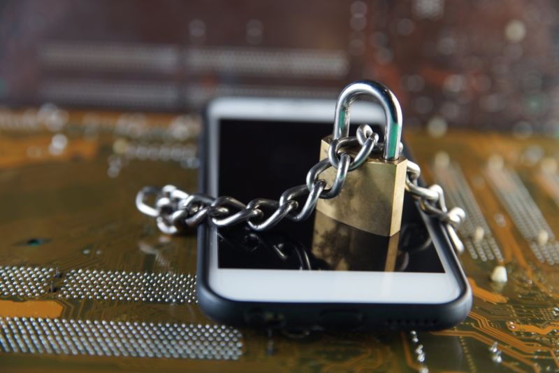 Image of a smartphone attached to a padlock.