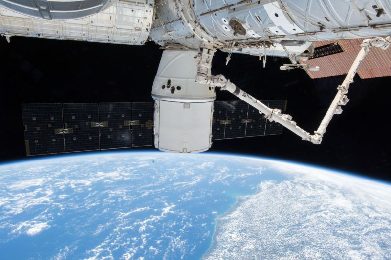 A SpaceX Dragon resupply ship with its dual outstreched solar arrays is pictured attached to the Harmony module as the International Space Station orbited above Brazil this month.