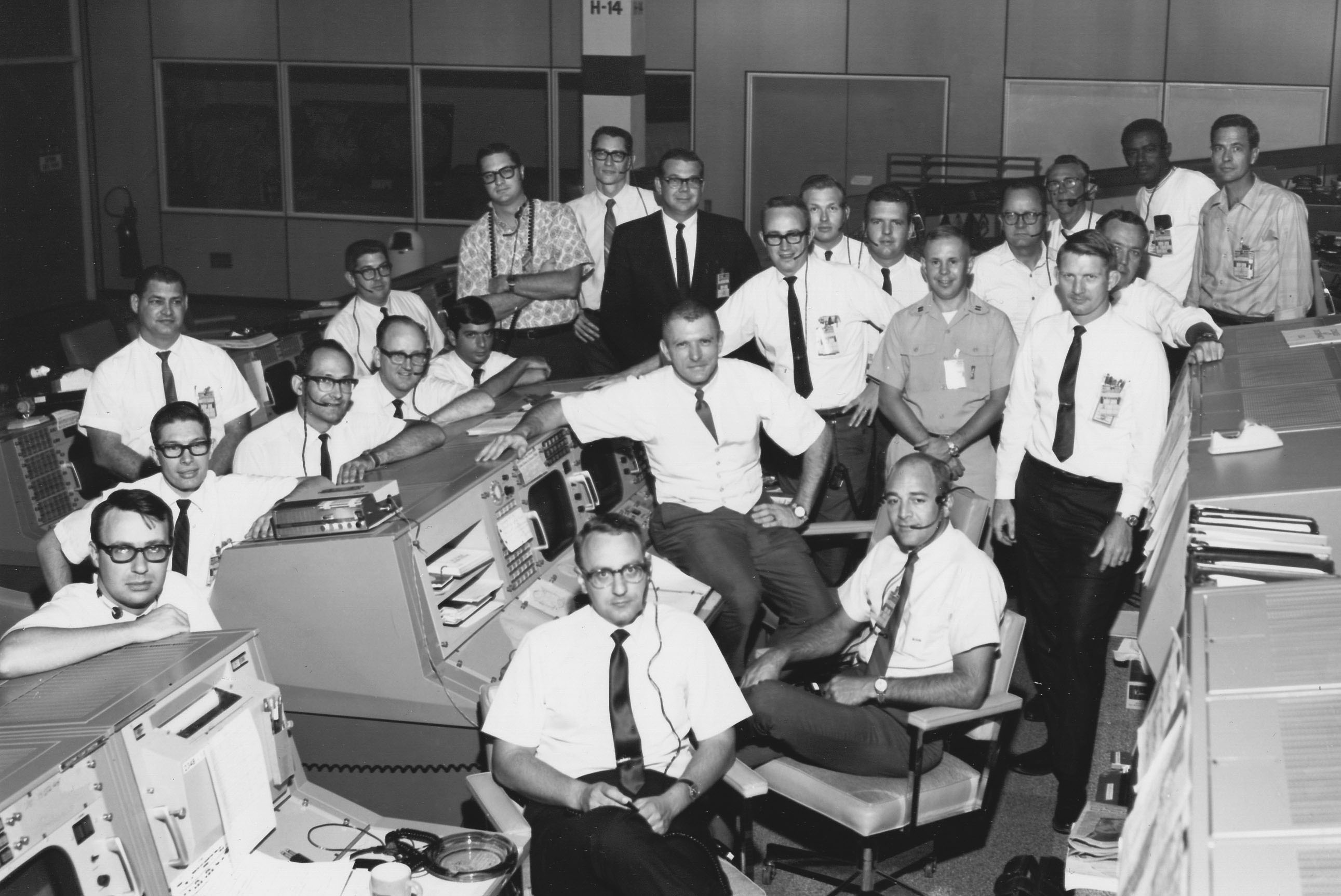 Glasses, skinny ties, pocket protectors, and short sleeves abound—these are the people who got America to the Moon.