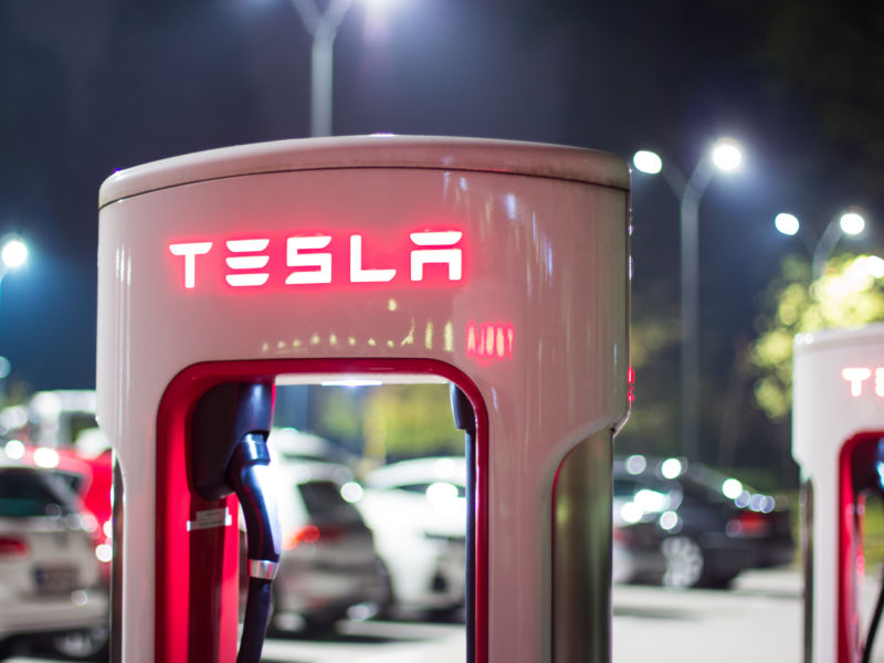 Ljubljana, Slovenia - October 13, 2016: Tesla car supercharger machine at Supercharger Station glowing at night