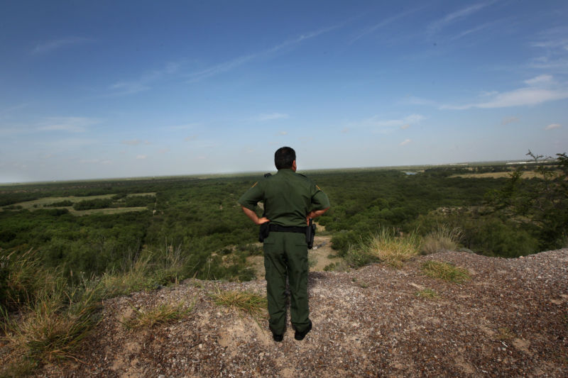 US Border Patrol supervisor Eugenio Rodriguez surveys the Rio Grande River and surrounding environs August 7, 2008 in Laredo, Texas.