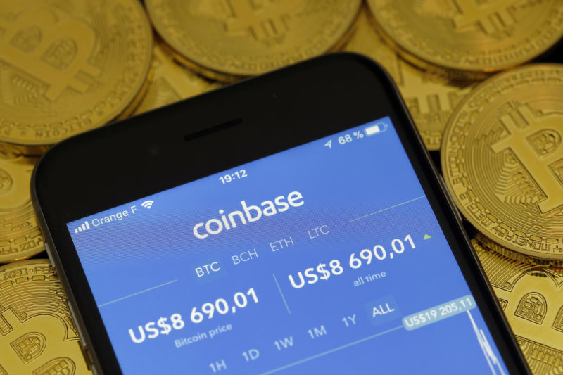 In this photo illustration, the Coinbase cryptocurrency exchange application is seen on the screen of an iPhone on February 12, 2018 in Paris, France.