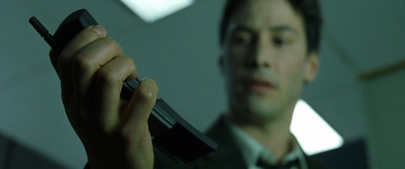 Neo gets a call on the original Nokia 8110.