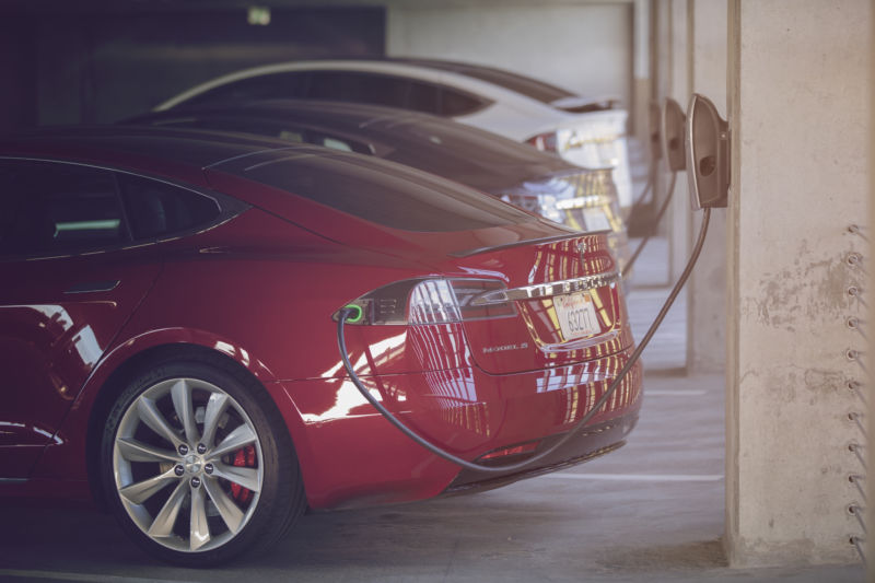 "Tesla's new ""workplace charging"" program would corner office parking spots"