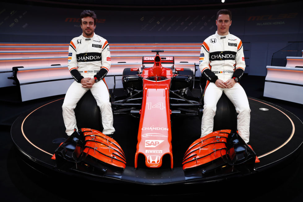 Fernando Alonso (L) and Stoffel Vandoorne (R) either side of their 2017 car, the MCL32.