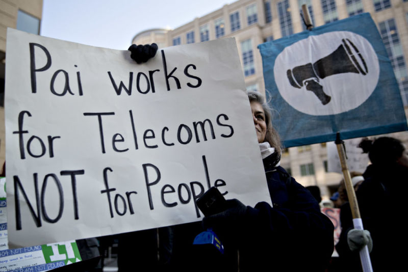 Net neutrality supporter holds a sign outside FCC on Dec. 14, 2017, before vote to repeal net neutrality rules.