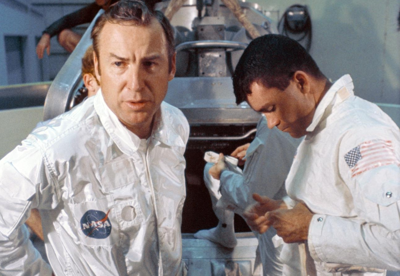 Mission commander James A. Lovell Jr., (left) and lunar module pilot Fred W. Haise Jr., (right) prepare to participate in water egress training.
