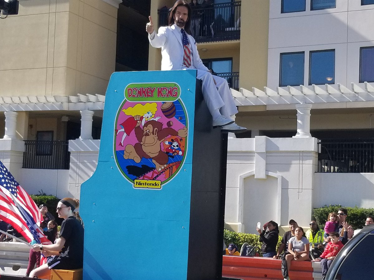 Mitchell rides an oversized <em>Donkey Kong</em> machine in the recent Citrus Bowl parade.