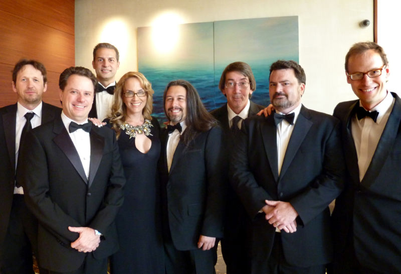 Tim Schafer (second from right) and Will Wright (third from right) share more than a love of nice formalware.