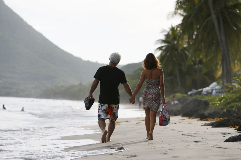 A couple on a beach in the Fench Caribbean island of Martinique. They should keep their shoes on.