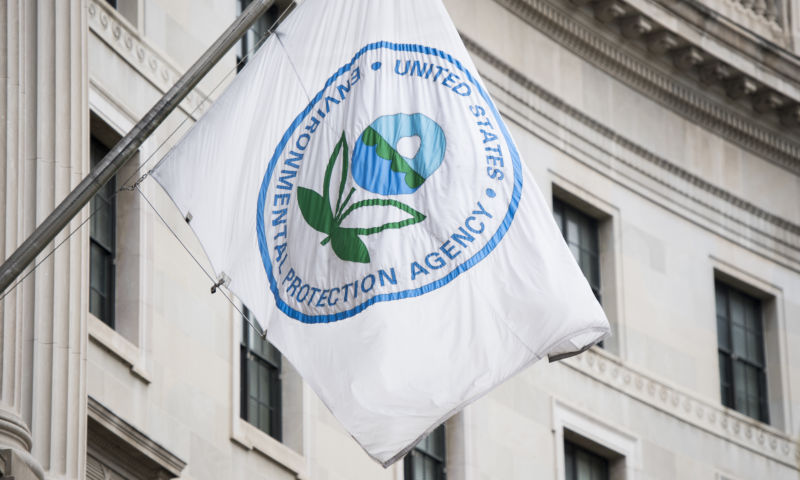 A flag hangs over an entrance to the Environmental Protection Agency in Washington on April 22, 2017.  (Photo By Bill Clark/CQ Roll Call)
