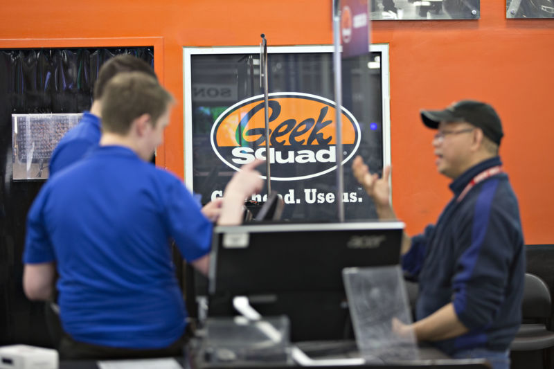 A customer speaks with employees at the Geek Squad counter inside a Best Buy store in Downers Grove, Illinois, on Tuesday, May 23, 2017.
