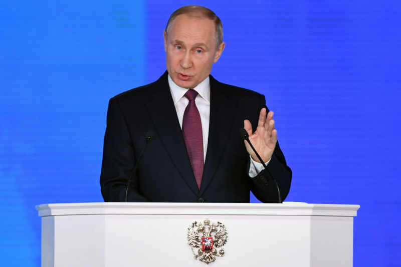 Russian President Vladimir Putin addresses the Federal Assembly at Moscow's Manezh exhibition centre on March 01, 2018. He announced a plethora of new strategic weapons that challenge the US' ballistic missile defenses.