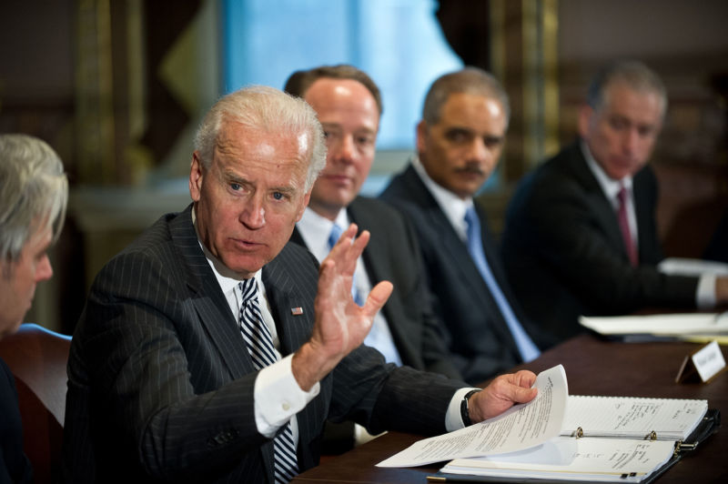 US Vice President Joe Biden speaks to a roundtable of game industry representatives as ESA CEO Mike Gallagher and Attorney General Eric Holder look on.