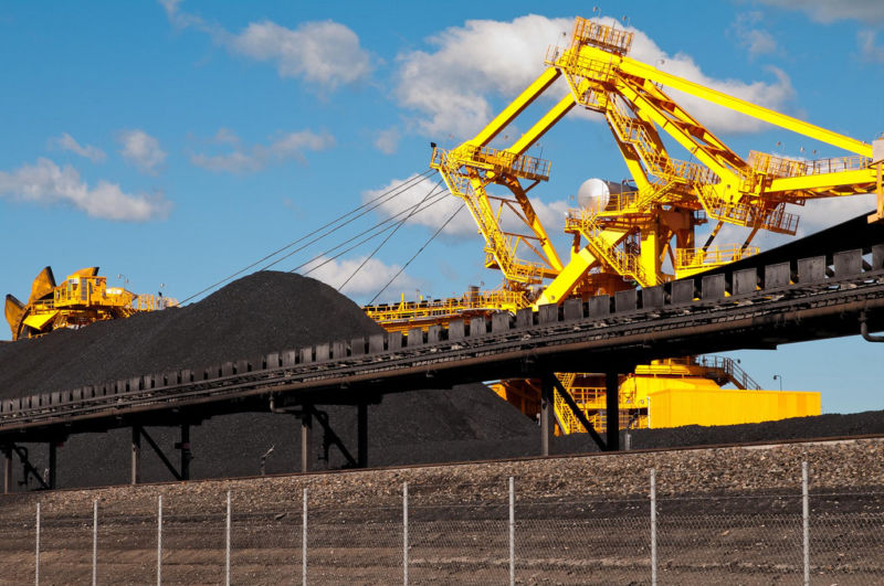 Piles of coal with machinery