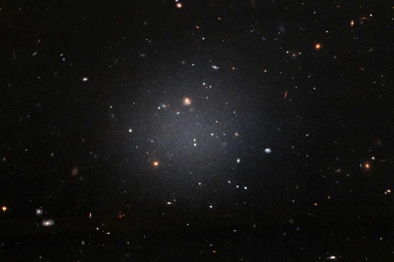The recently discovered galaxy is so diffuse that you can see other, more distant galaxies right through it.