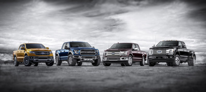 Four Ford trucks