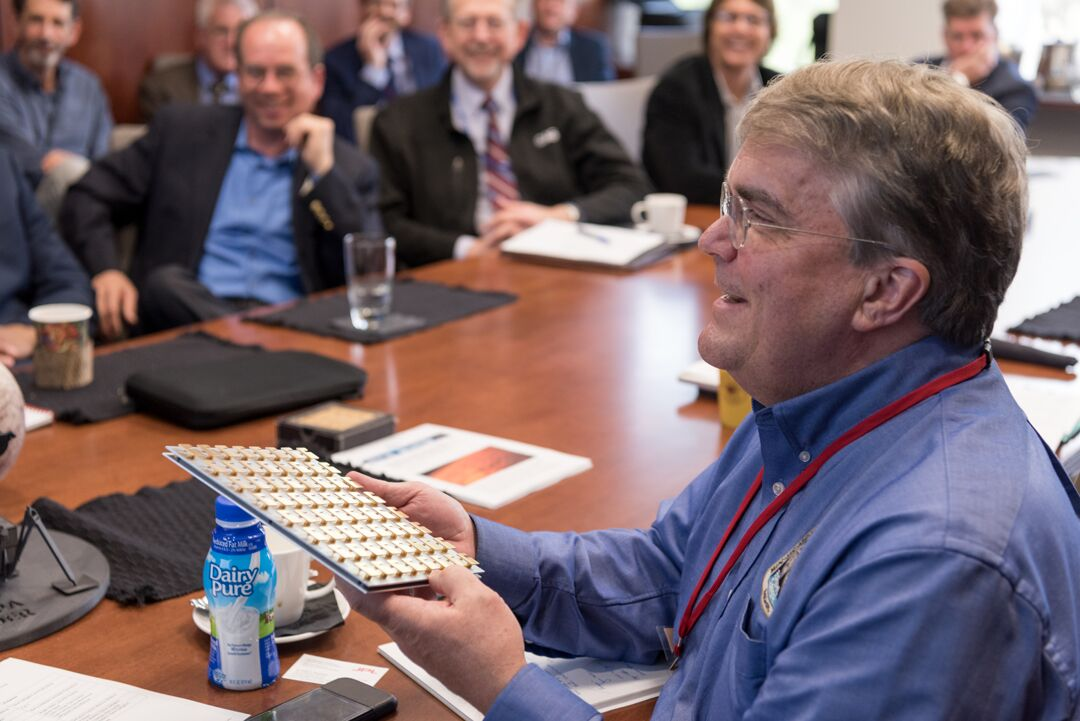 US Rep. John Culberson (R-Tex.) holds a prototype antenna for the Europa landing mission. In the background, at center, is NASA's Jim Green.