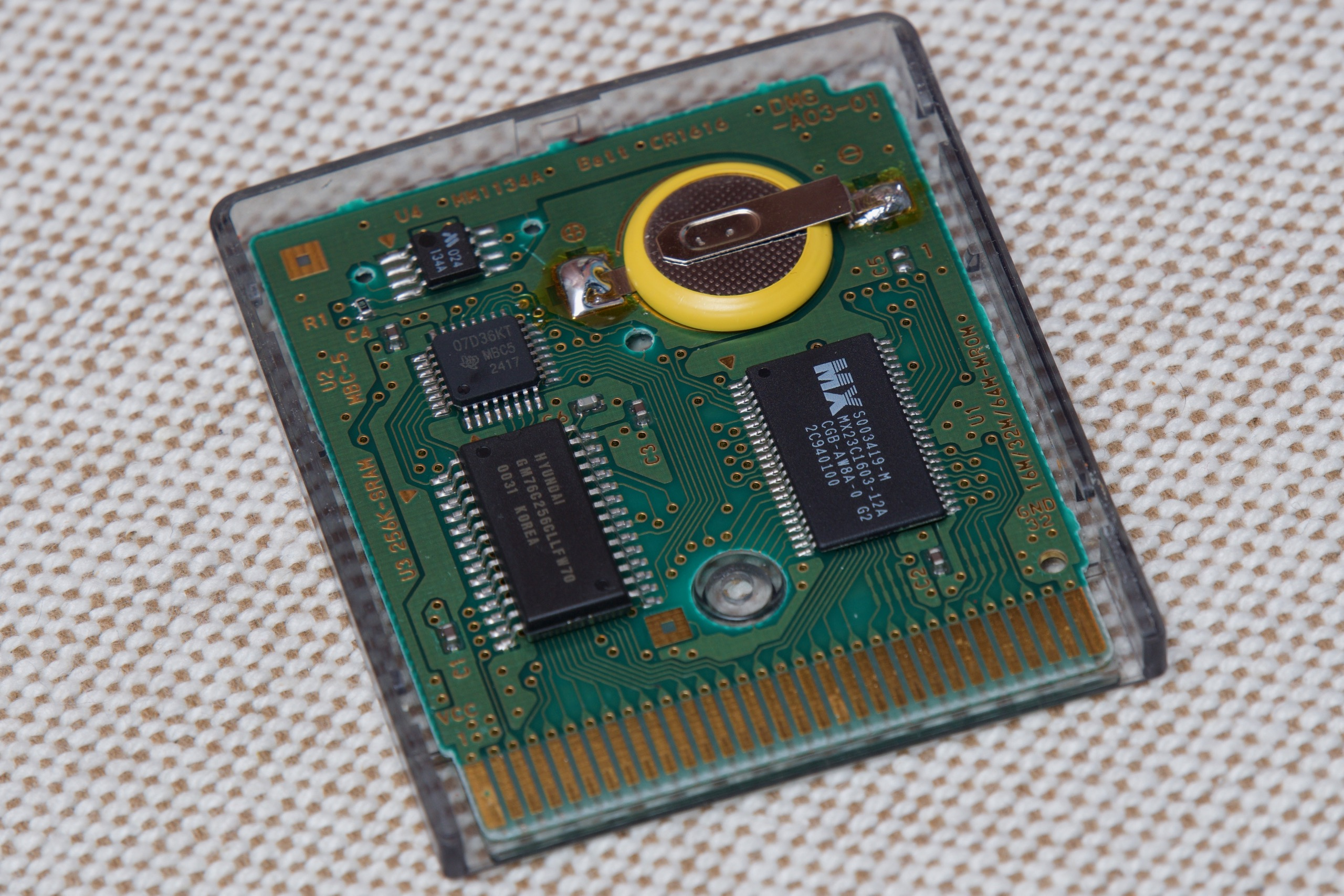 Sellers on eBay and Amazon offer batteries with pre-attached solder tabs specifically for old Game Boy cartridges. Even a novice solder-er should be able to swap them out without too much trouble.