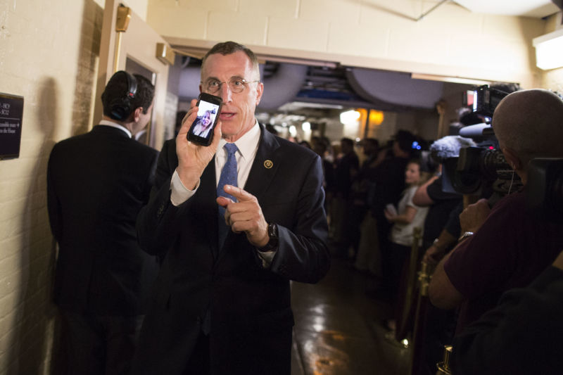 Rep. Tim Murphy (R-Penn.), shows his phone to the media as he FaceTimes his daughter at the Capitol in 2015.