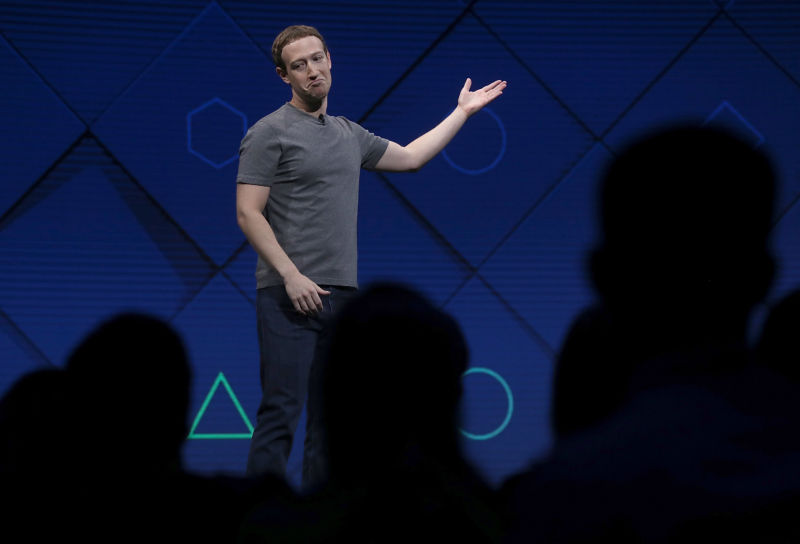 Mark Zuckerberg shrugs while addressing listeners at an event.