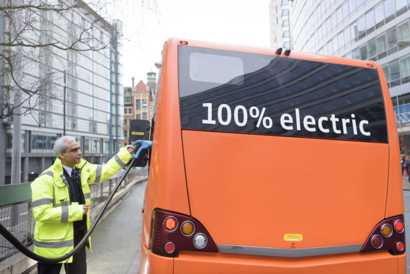 Man refuels an electric bus