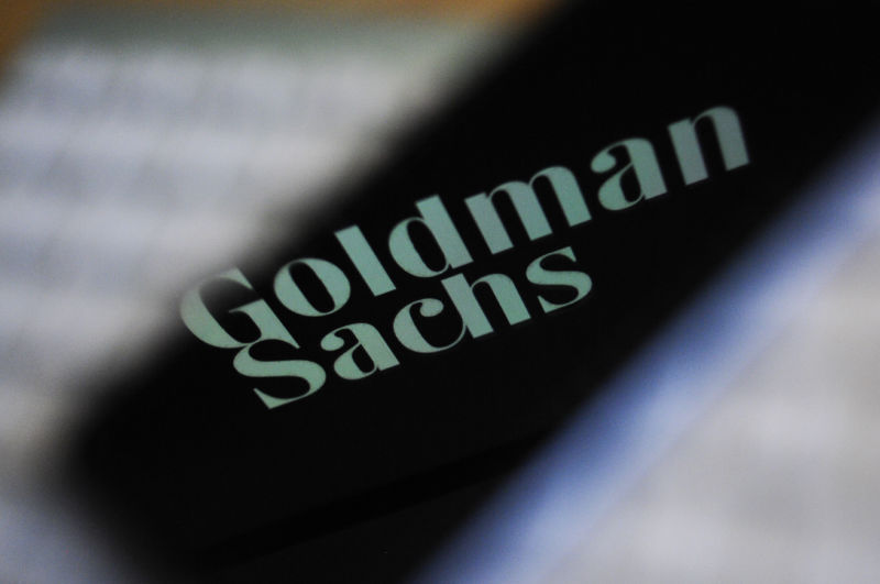 The Goldman Sachs bank logo is seen reflected on the screen of a mobile phone in this photo illustration on November 15, 2017.