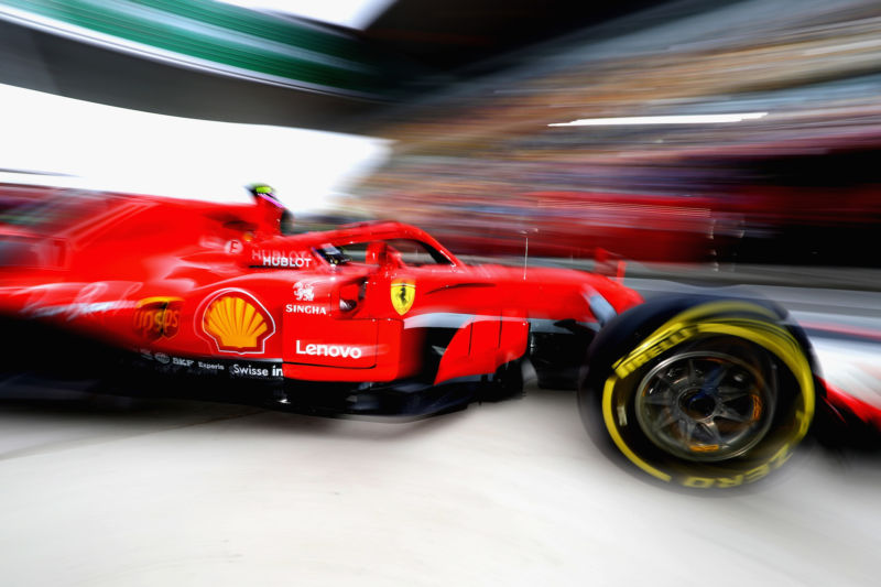 SHANGHAI, CHINA - APRIL 13: Kimi Raikkonen of Finland driving the (7) Scuderia Ferrari SF71H leaves the garage during practice for the Formula One Grand Prix of China at Shanghai International Circuit on April 13, 2018 in Shanghai, China.