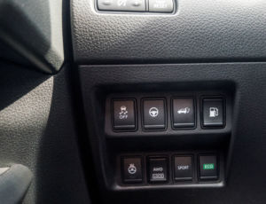 The buttons to change the Rogue into Eco or Sport mode live here by your left knee, out of sight and out of mind.