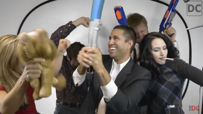 FCC chairman Ajit Pai holding a light saber and dancing in a crowd.