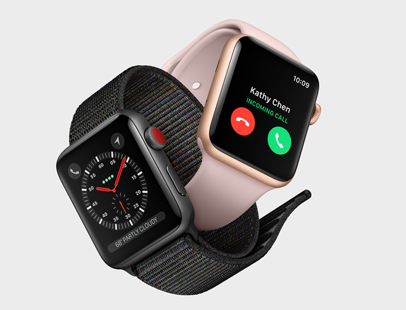 Two cellular-enabled Apple Watches, with one receiving a phone call.