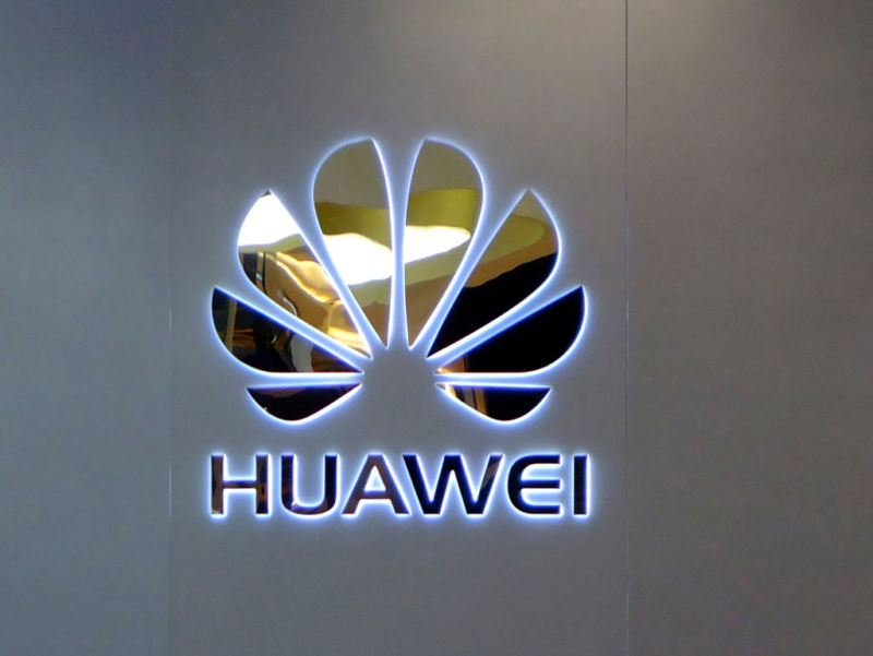 Huawei's corporate logo on a gray background.