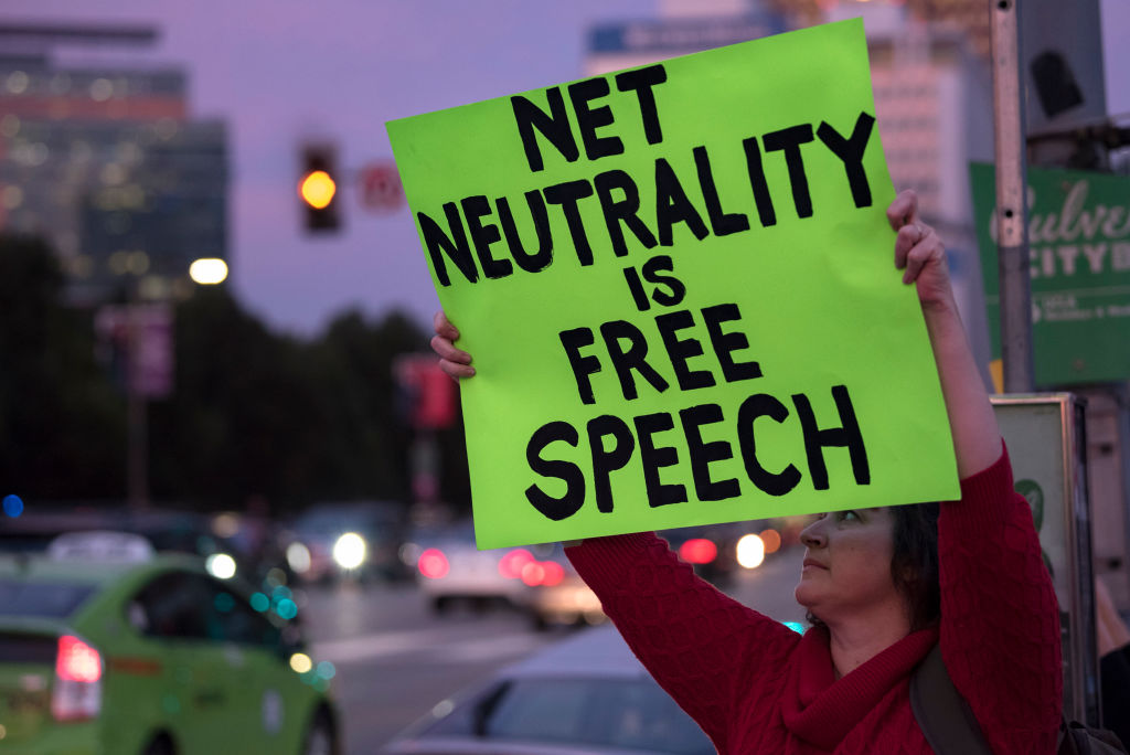Net neutrality supporter protests the FCC's repeal outside a federal building in Los Angeles, California, on November 28, 2017.
