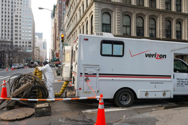 A Verizon worker and truck in a New York City street.
