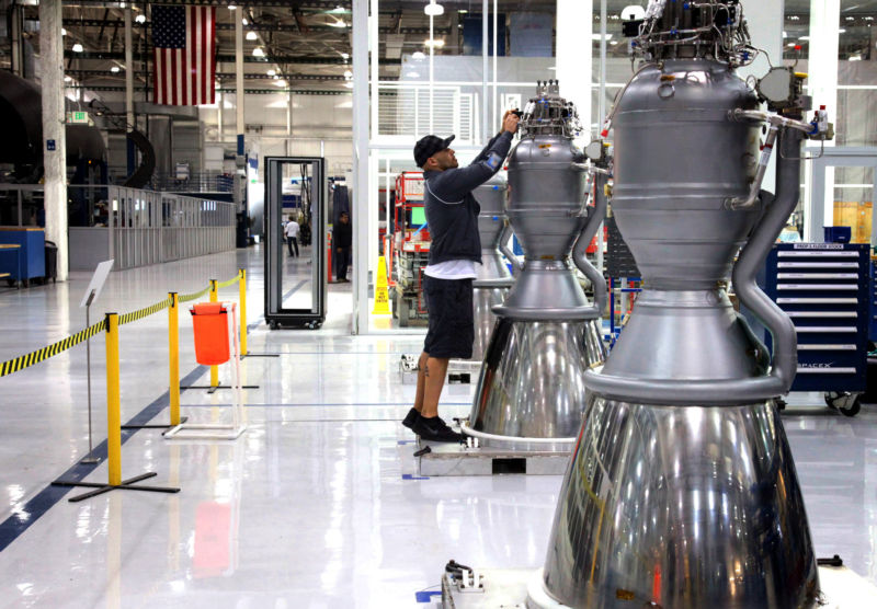 A glimpse of a SpaceX worker in Hawthorne: young, wearing a hat, possibly listening to music!