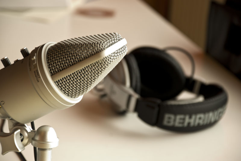 Image of headphones and a condenser microphone.