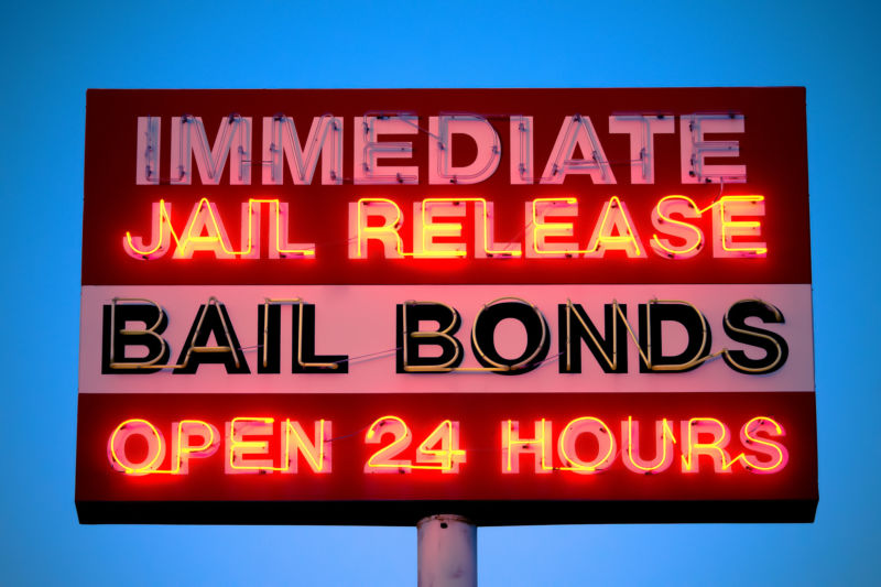 Neon sign advertising 24-hour bail bonds.