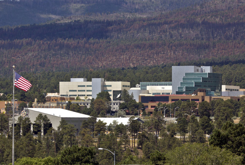 Image of a scientific research center nestled in a forest.