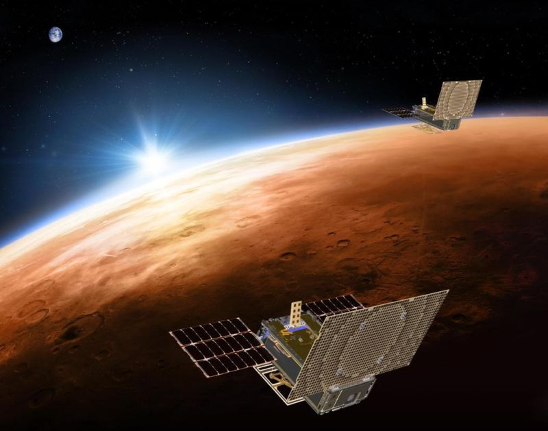 Artist's illustration of two CubeSats at Mars.