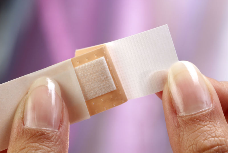 A close-up of someone opening an unused bandage