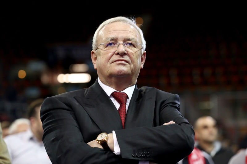Martin Winterkorn stands with crossed arms